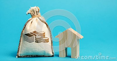 Money bag and wooden house. Concept of real estate market budget. Investment in construction. Saving money to buy a home or