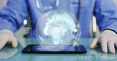 A physician, surgeon, examines a technological digital holographic plate represented the patient`s body, the heart lungs, muscles,