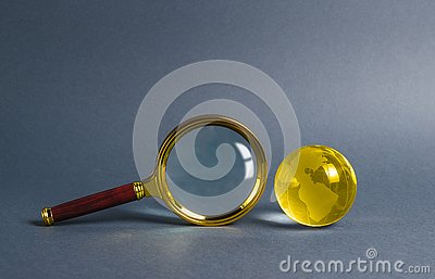 Magnifying glass and planet earth glass ball. Concept of global search and globalization process. International business