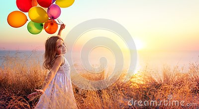 Happy Child In Freedom With Balloons
