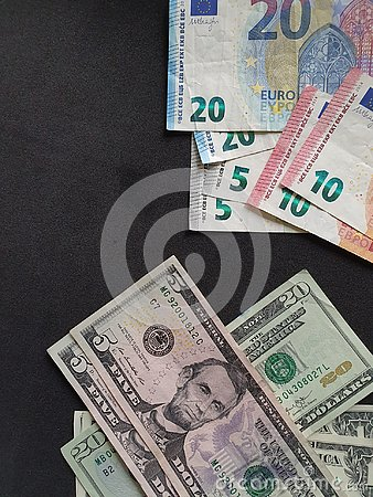 European banknotes and American dollar money on the black background
