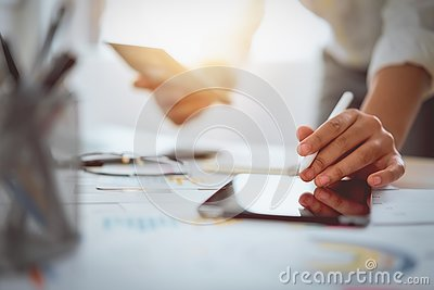 Digital marketing, businessman using digital tablet and documents on office desk background.