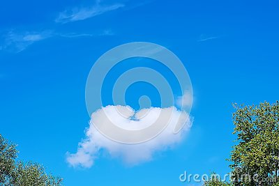 Heart-shaped cloud on a blue sky. Copy space. Concept of love, romance and valentines day