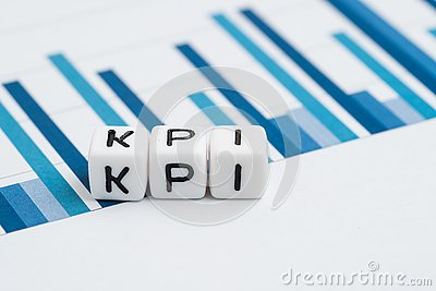 KPI, Key Performance Indicator concept, small cube block with alphabets building the word KPI on yearly chart and graph reports