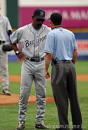 Willie Upshaw argues a call in a baseball game