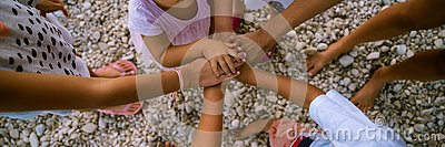 Six kids stacking their little hands