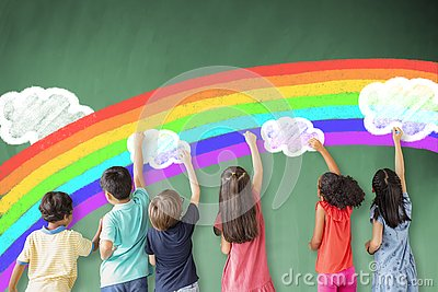 Children drawing rainbow and cloud on the chalkboard