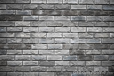 Gray brick wall. Old dirty cement wall texture. Abstract pattern. Dark vintage brickwork. Concrete stone grunge background.