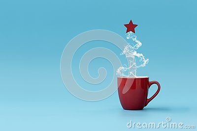 Christmas tree made of steaming coffee with red star. Morning drink. Christmas or New Year celebration concept. Copy space