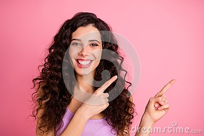 Photo of cheerful pretty charming fascinating kind good girl pointing at your best choice while isolated with pink