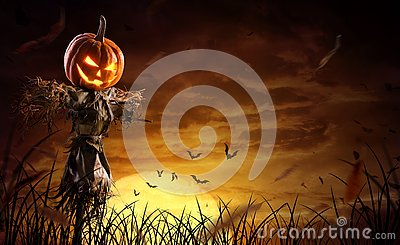 Halloween pumpkin scarecrow on a wide field with the moon on a scary night