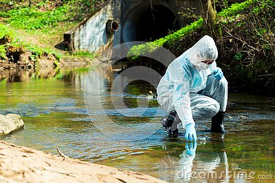 ecological disaster, contaminated water comes out of the sewage system - an ecologist takes a sample of water