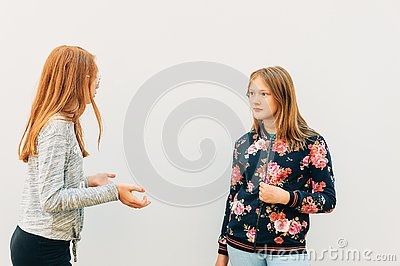 Young expressive girls having active conversation