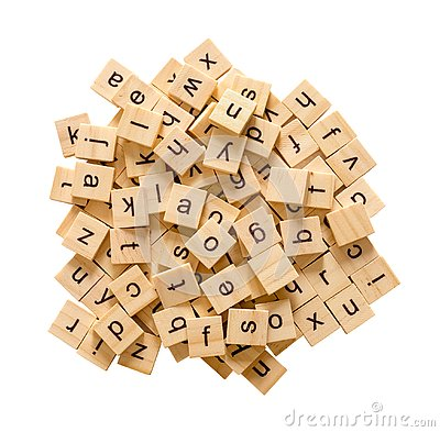 Pile of alphabet letters on wooden scrabble pieces, isolated on white background with clipping path