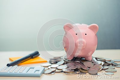 Piggy bank with coin note paper and calculator for personal account money saving concept