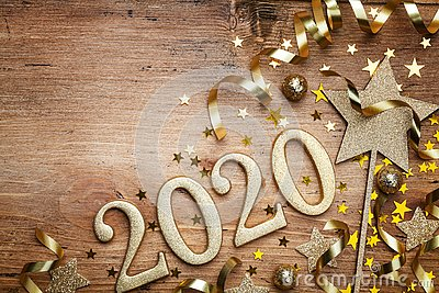 New Year celebration and festive background with golden numbers 2020, confetti stars and Christmas decorations top view