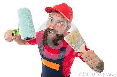 Painting works. Bearded laborer. Repair and renovation. Repair tips. Engineer architect. Man worker with paint roller