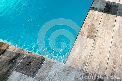 Outdoors corner swimming pool detail with blue water