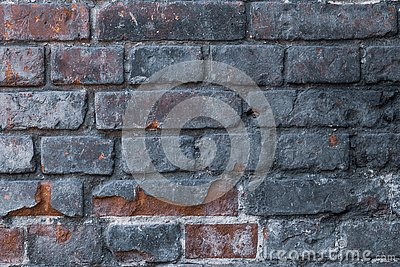 Old brick wall. Abstract gray dirty wall. Grunge texture. Dark vintage brickwork. Concrete stone background.