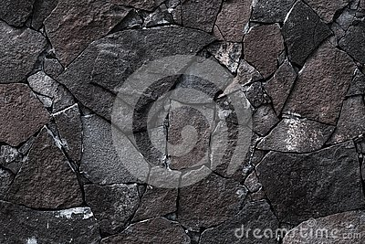 Dark stone wall background. Grey rock texture in retro style. Brick wall backgrounds. Abstract pattern. Gray stones, textured surf
