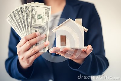 Business Real Estate and Residential Investment Concept, Broker Sell Agency of Property Estates Showing Money and House Model to