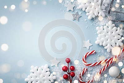 Christmas blue background. White snowflakes and holiday decoration top view. Happy New Year card