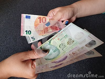 women hands exchanging European banknotes and American dollar money