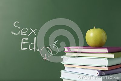 Books and apple with phrase `Sex ed`