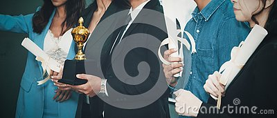 Business background of business people standing tohetger with trophy and certificate awards on hand