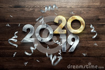 Creative design, Happy New Year, Metallic and gold numbers. Year 2019 is changing to 2020 Design on a wooden background. Merry