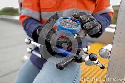 Engineer inspecting pull machinery testing chemical set fall arrest fall restraint abseiling anchor point