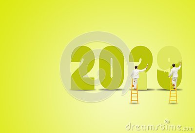 Painter standing on wooden ladder and painting words to change 2019 to 2020 for new year decoration.