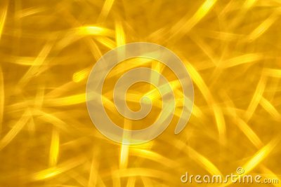 Abstract glitter golden glowing sparkling shiny background. Holiday gold wrapping paper texture. Christmas holiday seasonal