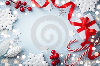 Christmas frame, greeting card. Gift or present box and holiday decoration on blue background top view. Happy New Year composition
