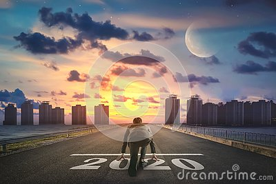 Businessman starting road to success 2020. Elements of this image furnished by NASA
