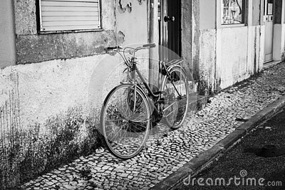Streets of Lisbon. Old bicycle. Black and white photo. B&W. Street photography