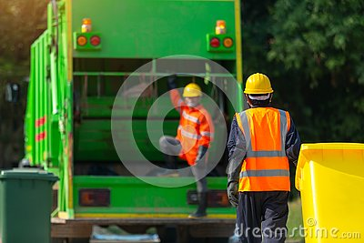 [garbage collector] Asian worker of urban municipal recycling garbage collector truck loading waste and trash bin in thailand,