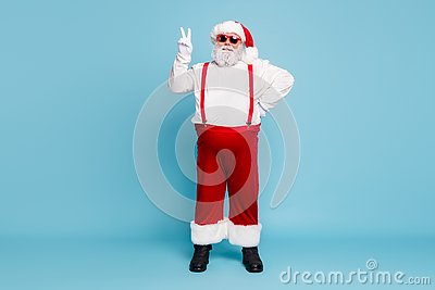 Full size photo of fat funky funny santa in hipster eyewear with funny big abdomen belly make v-sign enjoy christmas