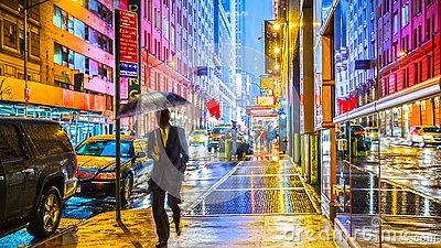 Stylish colorful wet New York NYC commuter with umbrella