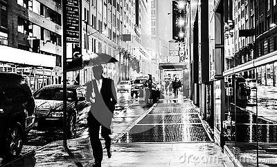Stylish black and white wet New York NYC commuter with umbrella