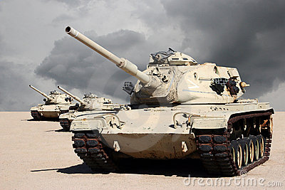Three Army War Tanks in Desert
