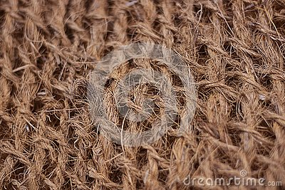Rough fabric with huge network made from natural raw plant fiber. Detail, closeup. Horizontal. brown tone. Wallpaper and