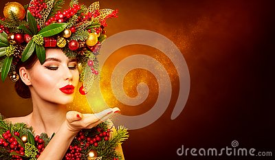 Christmas Fashion Model Beauty Makeup, Wreath Hairstyle. Xmas Woman Blowing to Hand, Beautiful Artistic Portrait