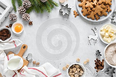 Christmas or X-mas baking culinary background, cooking recipe. Xmas, Noel gingerbread cookies on kitchen table and ingredients