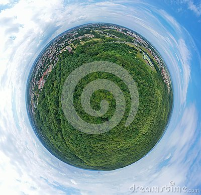 Aerial drone 360 degree panoramic view on green lungs forest surrounding european city during summer, aquapark complex