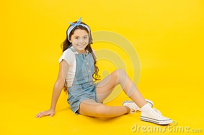 I love changing my style. Adorable small girl relax in fashion style. Little cute child with long brunette hair style on