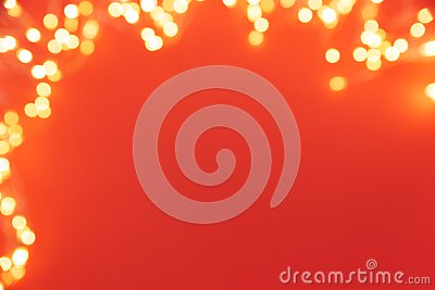 Frame of defocused Christmas lights on red background. Christmas and New Year holidays celebration concept