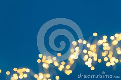 Border of defocused Christmas lights on red background. Christmas and New Year holidays celebration concept