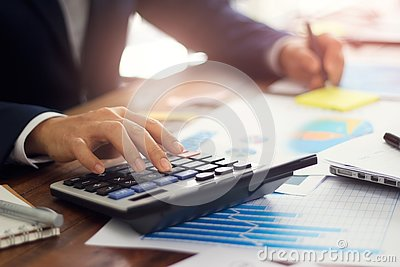 Businessman using calculator to calculate budget, Payments, Business financing and accounting banking concept