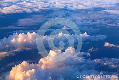 Beautiful above sky panoramic view from airplane. Skyline background panorama during sunset